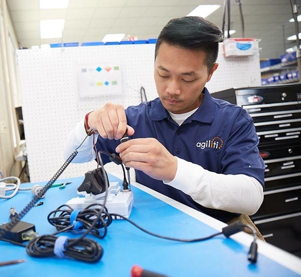 A BMET performing preventive maintenance and repair on medical equipment